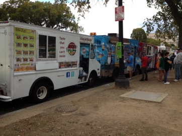 A queue of food trucks out by the D.C monument. Nom-fest 2013
